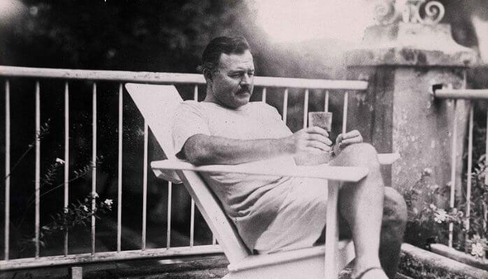Ernest Hemingway sitting