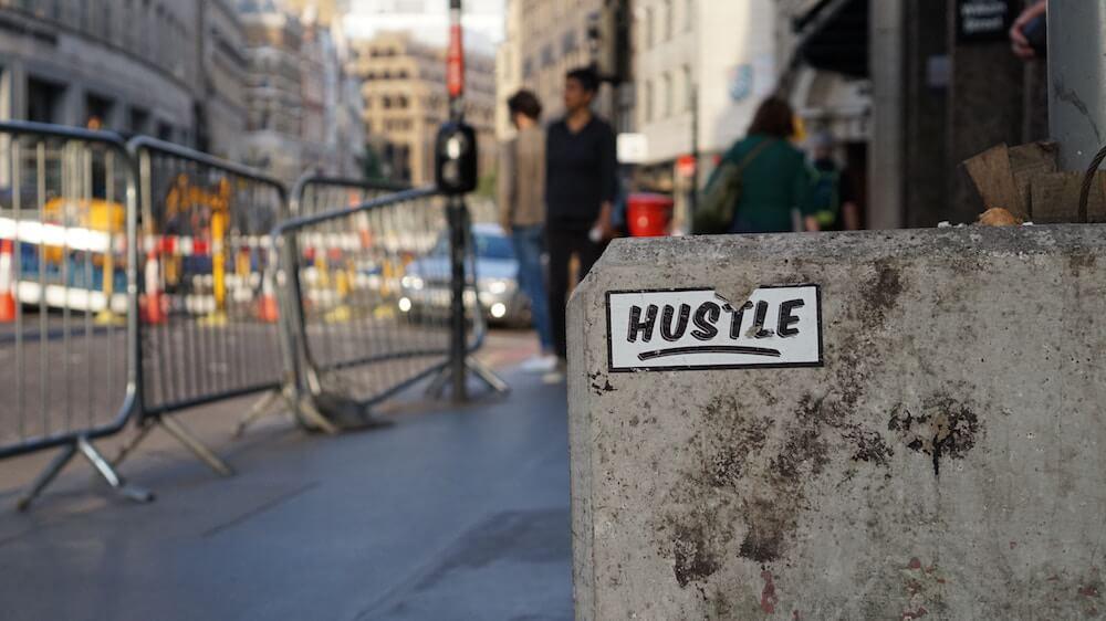 Hustling sticker on wall